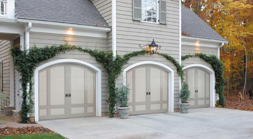 Amarr Residential Doors - Biltmore Estate Amherst with Santiago Knockers, Custom Painted by Homeowner.