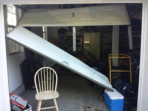 Garage Door Accidents & Why They Happen; damaged garage door 2.jpg
