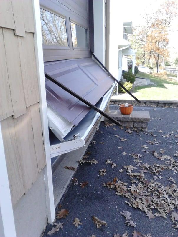 Garage Door Accidents & Why They Happen; result of garage door hit by car.