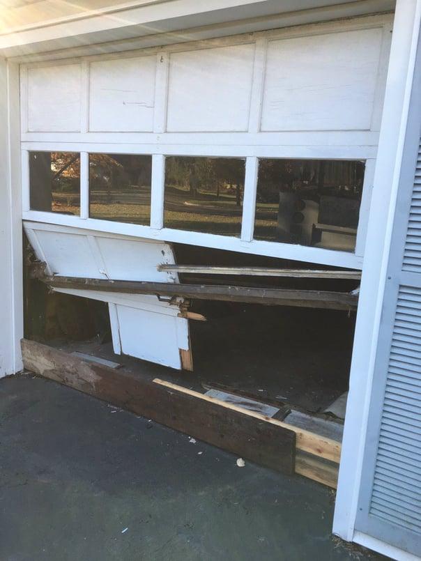 Garage Door Accidents & Why They Happen; ugly, broken garage door.jpg