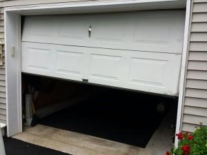 how to stop garage door squeaking