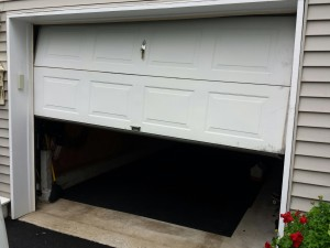 how to stop garage door squeaking