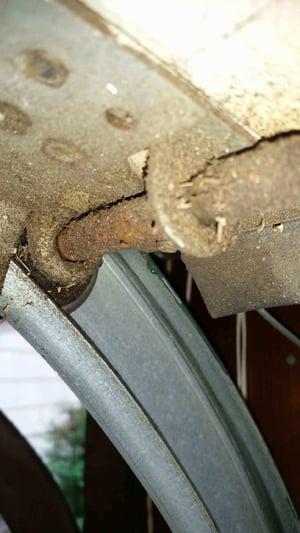Old and rusty garage door roller