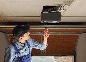 Residential Garage Door Opener Being Serviced