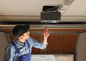 Residential Garage Door Opener Being Serviced