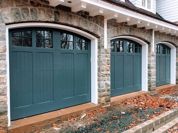 Paint-Grade Wood Doors with glass panels by Overhead Door Company of Central Jersey.