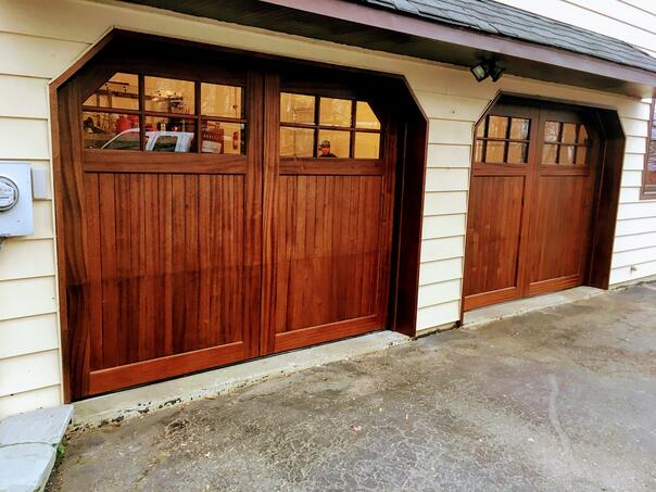 Stain Grade Wood Doors with glass panels by Overhead Door Company of Central Jersey.