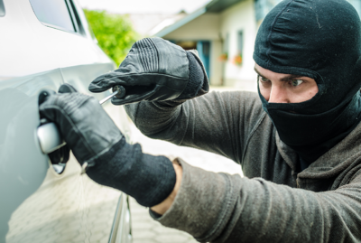 Thief Opening a Car