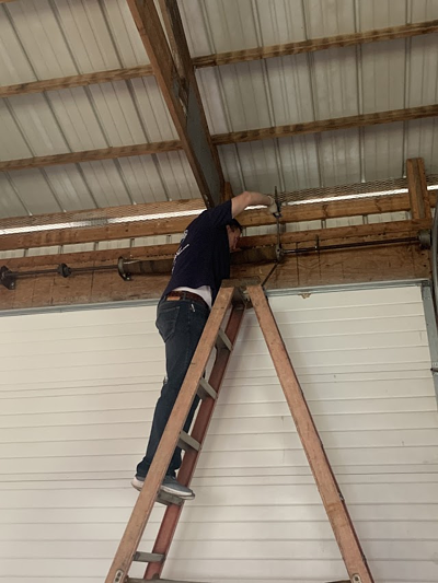 Technician repairing a commercial door in Central Jersey