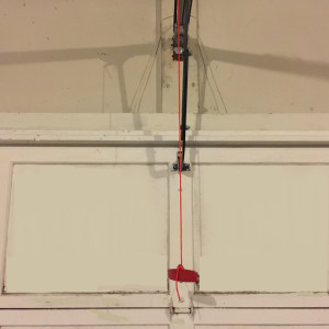 I Pulled My Garage Door Release Cord. How Do I Reattach It?