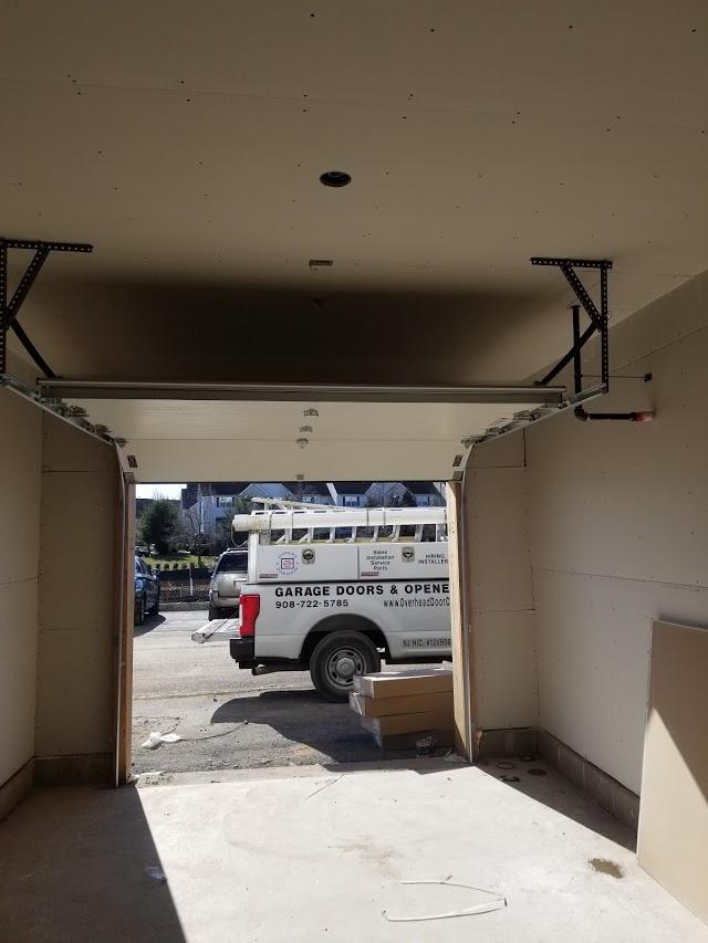 Photo gallery traditional steel garage doors 2 car wide traditional steel garage door white finish with standard panel rubansaba